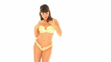 Sexy brunette dancing in yellow lingerie