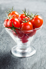 Fresh cherry tomatoes with stalks