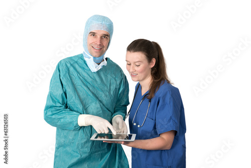 surgeon and young female doctor using tablet-PC