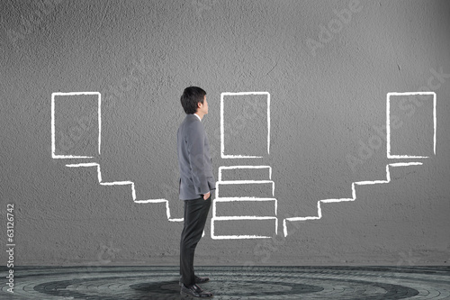 Businessman looking and drawing stairway