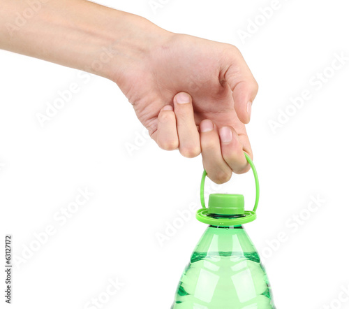Hand holding plastic bottle.