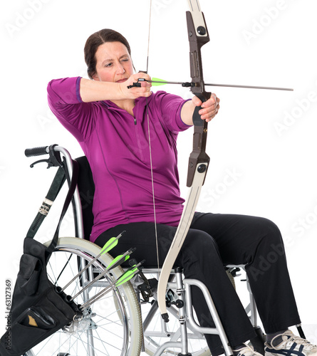 woman in wheelchair shuting bow