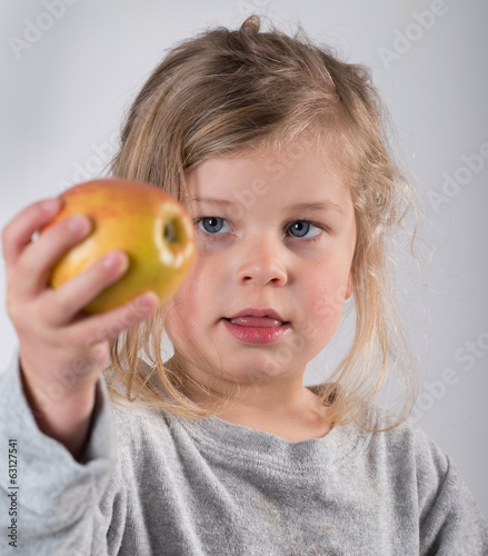 child keeping up a apple