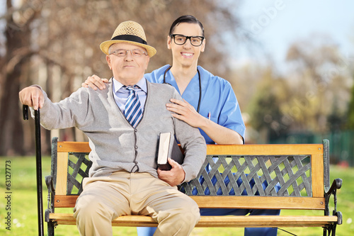 Healthcare professional posing with a senior man