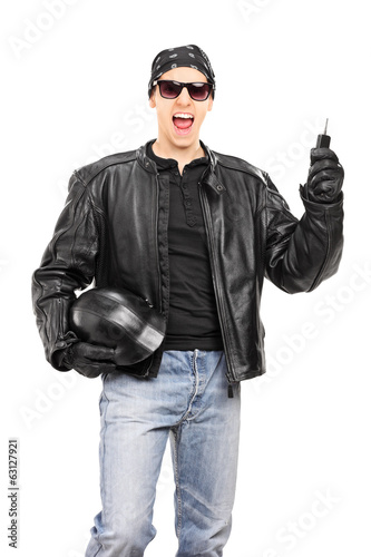 Male biker holding key and a helmet isolated on white background