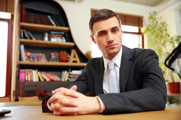 Confident businessman sitting at office