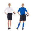 back view of woman in blue soccer uniform and businesswoman with