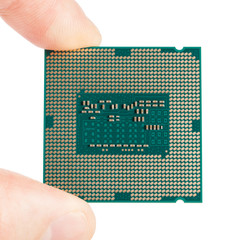 Computer's processor in hand on a white - 1 to 1 ratio