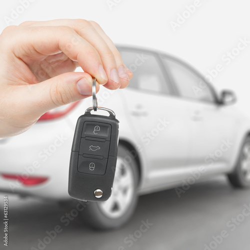 Male holding car keys with remote control system - 1 to 1 ratio