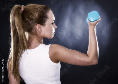studio portrait of a beautiful sporty muscular woman working out