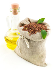 Sack of flax seeds and glass bottle of oil with leaves