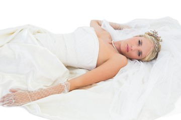 Sensuous bride lying over white background