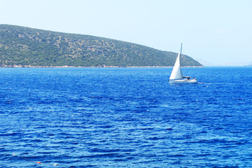 The sail yacht on turquoise water near beach, Bodrum, Turkey