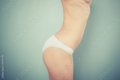 Slender woman in white underwear
