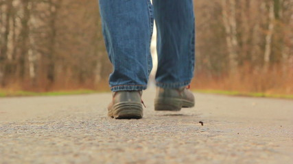 move along the road,man walking along the road