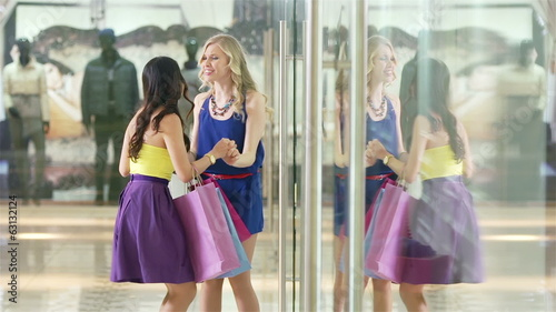 Charming girls going to the clothing department