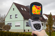 canvas print picture - analysing a one-family house with an IR camera