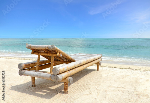 Relaxing Chair on white sandy Beach