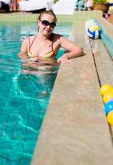Beautiful  woman smiling in a swimming pool