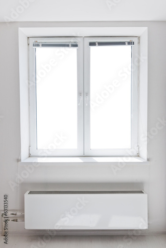 White plastic double door window with radiator under it.