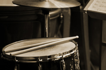 Drum sticks lying on the drum closeup