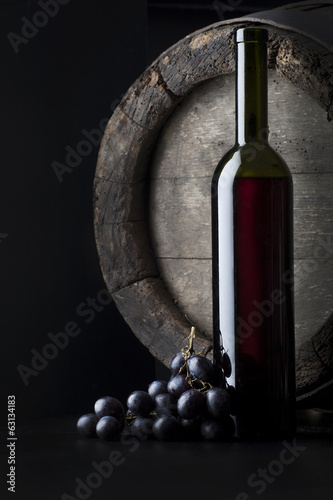 still life with bottle and cluster