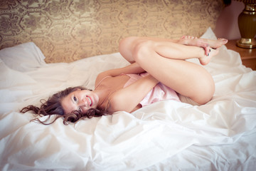 Young sexy woman relaxing in bed