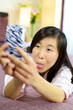 Asian girl having fun making funny faces for selfie