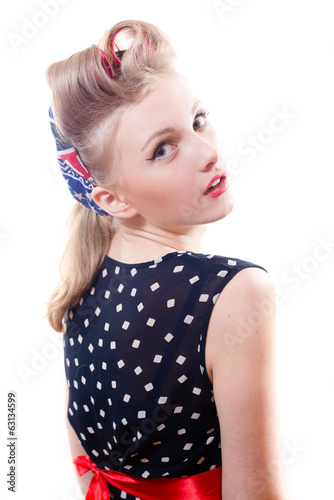 Pretty girl funny young blond pinup woman in polka dot dress