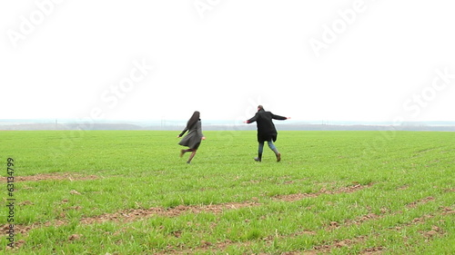a man and a girl running around the field,