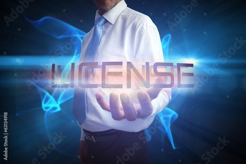 Businessman presenting the word license