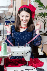 Funny pinup woman with sewing machine and tape