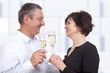 Man and woman celebrating with champagne