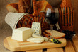Glass of red wine and homemade cheese