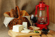 Still life with homemade cheese, cheese and wine