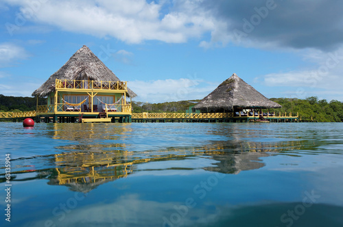 Foto op Canvas Caraïben Tropical bungalow and restaurant over the sea