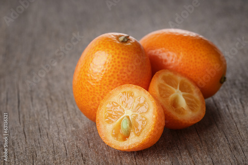 fresh kumquat on wood table