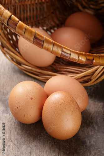 speckled chicken eggs on old table