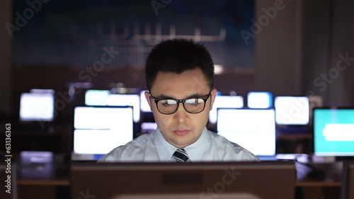 White-collar worker in eyeglasses networking in office