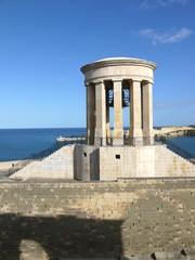 Stone monument with bell, La Valleta city old center, Malta
