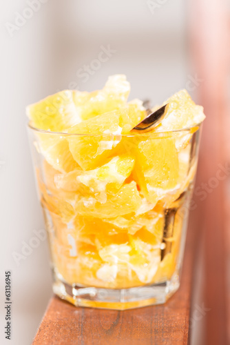 Orange salad in glass vertical