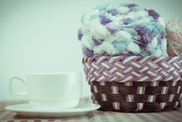 Cup of coffee and Knitting yarn balls.
