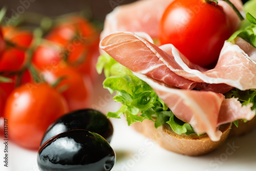 Ham sandwich with tomato and olive
