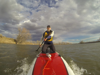 kneeling on stand up paddleboard