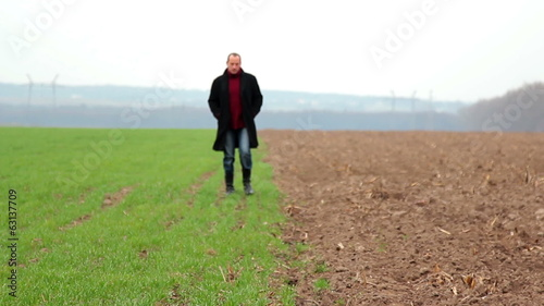 man walking in the field,agronomist examines the field