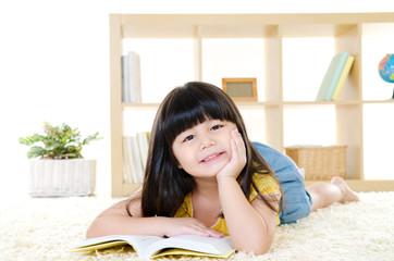 Cute little girl reading