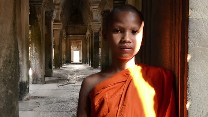 cambodian monk in angkor wat temple