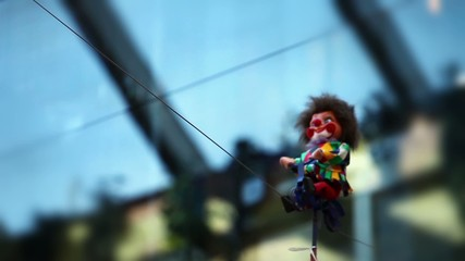 Clown on bike rides along the rope