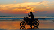 Motorcyclist at sunset on the beach. - 63139544