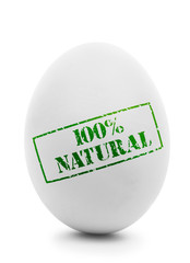 White egg with grunge label 100% Natural isolated